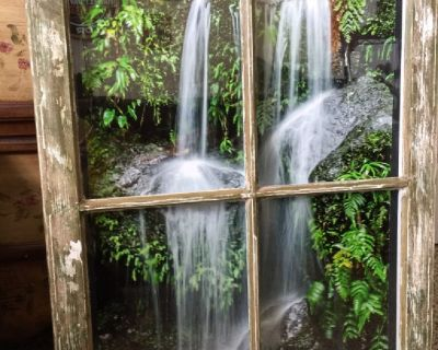 Waterfall picture in an old rustic painted window frame
