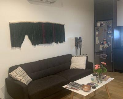 Bedroom w/ Closet and Large Windows