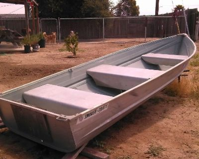 1985 SmokerCraft 12 ft aluminum boat 7.5 Mercury outboard engine w/ 5 gallon external gas tank. All papers/tags up to date. $600.