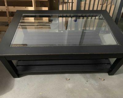 Distressed black wood coffee table