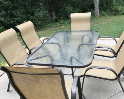 Glass patio table and 6 chairs