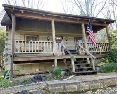 75 Acres with Log Cabin in Wright City.