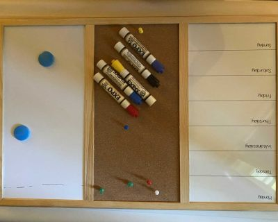 Dry erase board with 5 markers GUC, black mark across the top but I bet a magic eraser would erase!