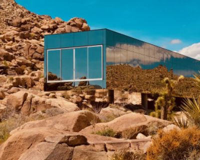 Invisible House mirrored nestled in 90 acres of rocks like another planet sci fi beyond, Joshua Tree, CA