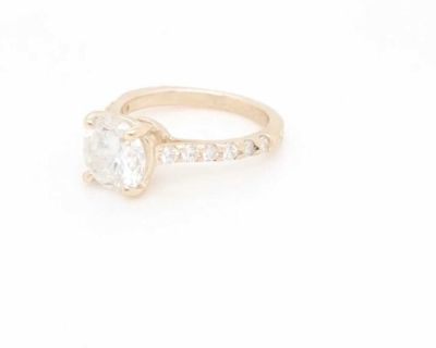 1.65 ct. Round Brilliant Cut Diamond Set in a 14K Yellow Gold Diamond Setting, Financing available.