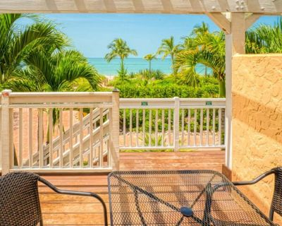 Sapphire blue water, white sandy beaches just steps from your front door and a luxury villa. - Captiva