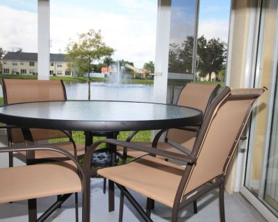 Luxury Water View Gated Villa 5 miles from Disney W/ Free WIFI, Pool, Gym - Kissimmee