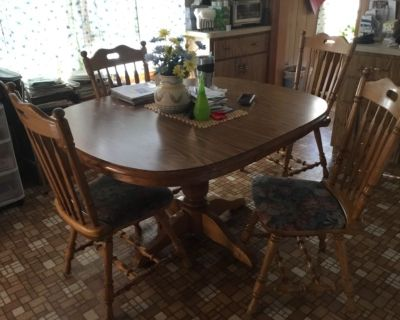 Offered: pedestal oak table and four chairs,