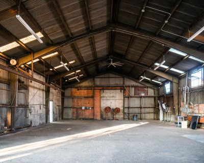 Huge metal Rustic hangar with car drive-in, boxing ring, and dedicated MUA & production rooms, Free Parking - Olympic 5, Los Angeles, CA