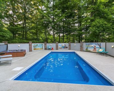 Resort style living - heated pool, hot tub, game room, pond and ample parking! - Oakland Hills at Geist