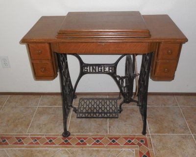 solid oak antique peddle sewing maching    good working condition