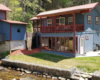Rustic two-story cabin on creek with covered bridge and water wheel... - Upper Peachtree
