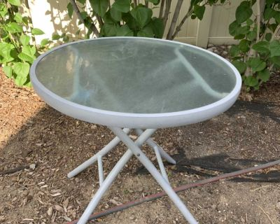 Grey metal table with glass top