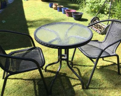 2 Black patio chairs with table