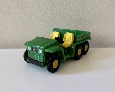 John Deere plastic Gator with back that can lift up and down.