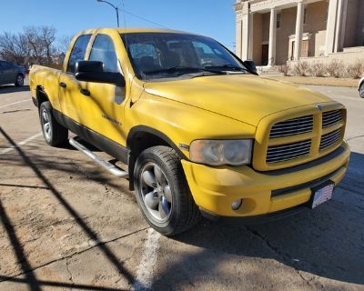 2004 Yellow Dodge Ram Quad Cab Sport