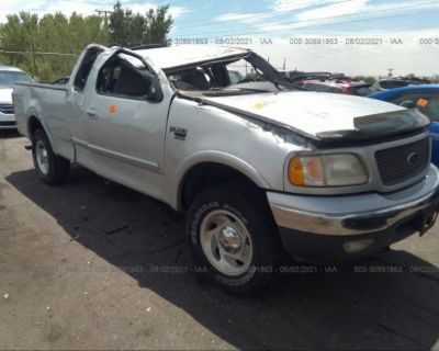 Salvage Silver 2000 Ford F-150