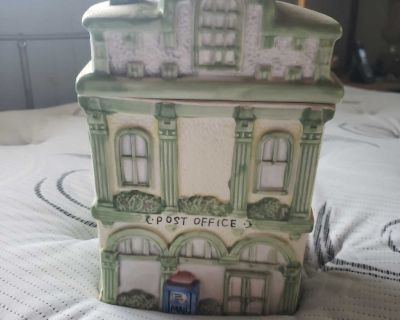Collectible ceramic Victorian style house cookie jar