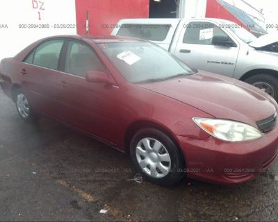 Salvage Red 2002 Toyota Camry