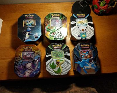 Pokemon tins with trading cards