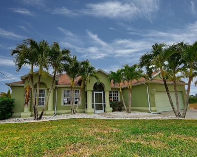 NW Cape Coral Vacation Rental 4 bedroom 2 bathroom home, pet friendly, private heated pool, and dock - Burnt Store