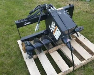 Brand New Lowe and Belltec post hole augers. Lowe models 750 and 1650 models