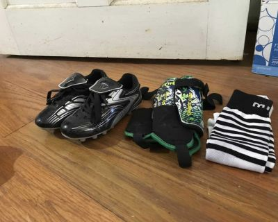 Brand New Soccer cleats, shin guards and socks.