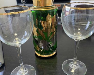 Vintage glass decanter with gold trim