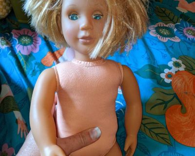 American girl doll with cut hair and no clothes