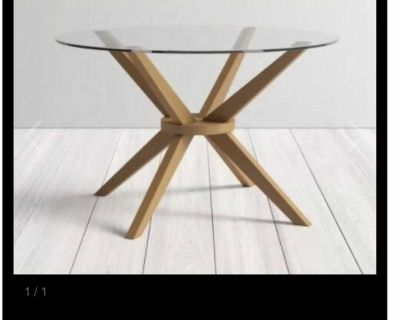 Solid wood dining table with glass top