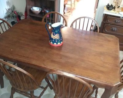 Solid wood table with six solid wood chairs all sturdy