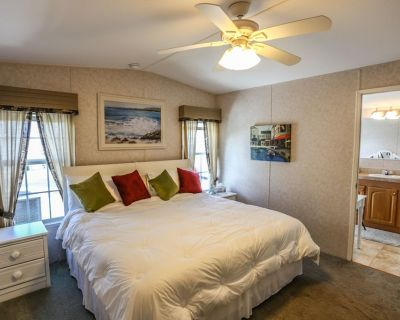 Welcome to 36 Emily Lane, a 2 bedroom, 2 bath canal-front manufactured home located on the mainland just a short 2-3 minute drive from Fort Myers Beach - Fort Myers Beach
