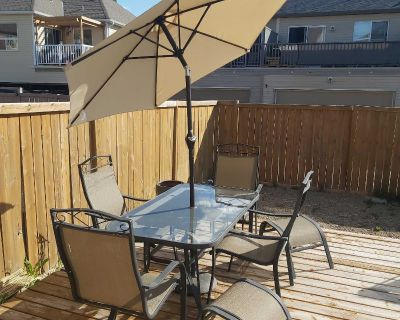 patio table, 4 chairs, 2 foot stools and brand new umbrella