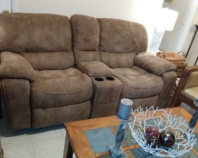 Double rocking recliner loveseat with cubby and cup holders