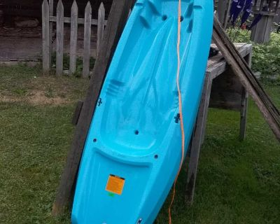 Youth Kayak, paddle included, holds up to 130lbs, 6 ft. Kid outgrew