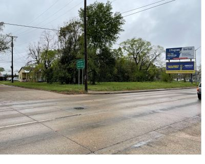 Commercial Lot on SE Evangeline Thruway with Sign Income