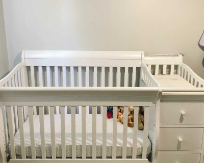Convertible crib with attached Change table