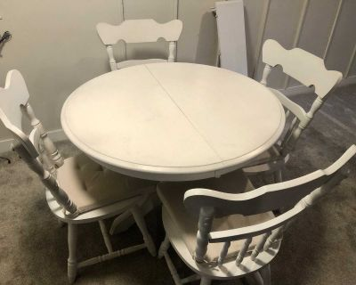 Dining table with Four chairs and leaf insert.