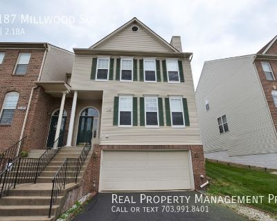 Beautifully Updated End Unit Townhouse in Desirable Potomac Hunt.