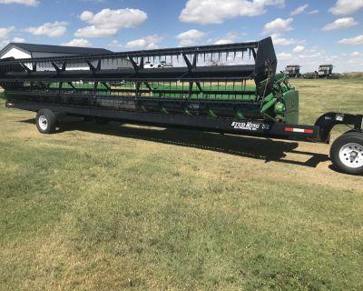 John Deere 930R combine header and trailer