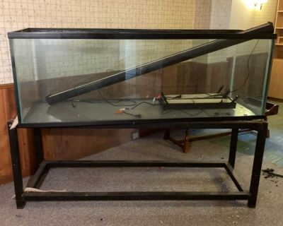 Huge reptile aquarium. Not for fish. Includes stand. 6 long 24 high and 24 wide. 3/4 thick glass. Requires multiple people to pickup its