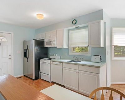 White Kitchen Cabinets With Corian Counter And With All Appliances