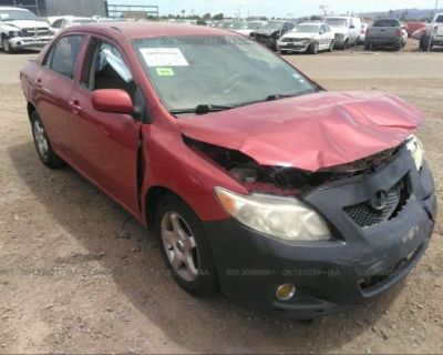 Salvage Red 2010 Toyota Corolla