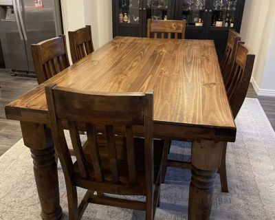 Wood farmhouse table with six slatted chairs