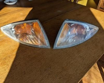 2000 Chevy Cavalier front park light assembly both sides