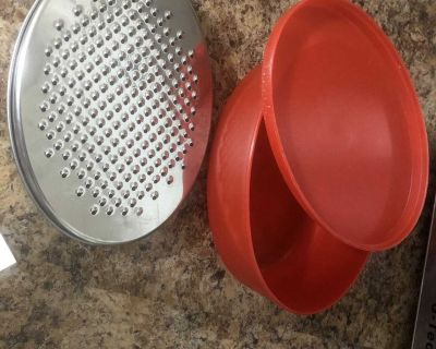 A cheese grater with storage container