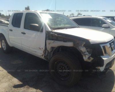 Salvage White 2012 Nissan Frontier
