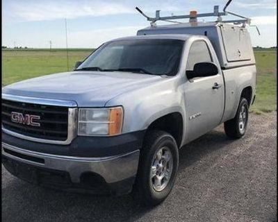 2011 GMC Sierra pickup with topper