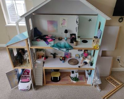 Remodeled barbie house with lots of goodies, car, horses and barbies