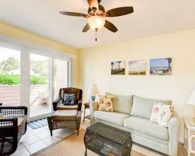 Walk to the white sands of Crescent Beach from this airy two-bedroom villa! You - Butler Beach
